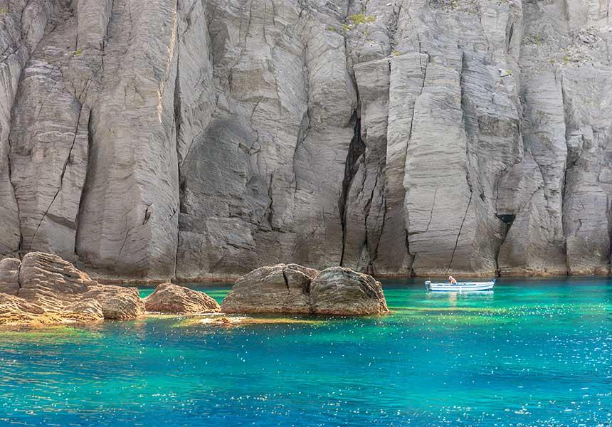 Lava rocks an clear sea in Salina Island