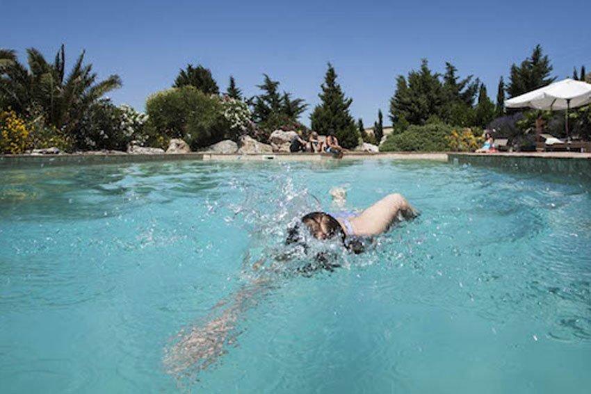 swiming in a villa's pool in Sicily